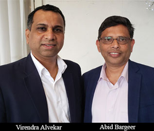 Virendra Alvekar and Abid Bargeer, Managing Partners, GCOM Software